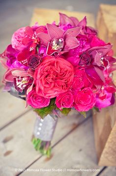 Pair various blooms, like orchids and roses, insimilar hues for a dynamic wedding bouquet.