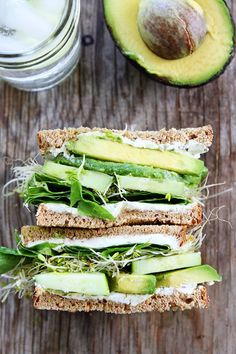 Cucumber and Avocado Sandwich Recipe on twopeasandtheirpo. This fresh and simple vegetarian sandwich is made with cucumber, avocado, lettuce, sprouts, and herbed goat cheese. It is great for lunch or dinner. recipes for two recipes fry recipes Avocado Sandwich Recipes, Veggie Recipes, Lunch Recipes, Cooking Recipes, Vegetarian Sandwiches, Cucumber Recipes, Veggie Sandwich, Sandwich Ideas, Snacks