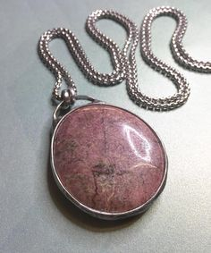 Amanah  Large Rhodonite Palm Stone Pendant