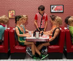 Kens at the Diner After Wrestling Practice Diorama - Table, benches, napkin dispenser, menus and signs by the Morrison Furniture Studio. Wrestling singlets by DollyKnickers.