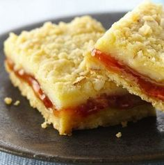 Add some sunshine to your next potluck or backyard party with these sweet, tangy, creamy squares. No fruit required—simply use a cup of strawberry preserves or jelly. The secret ingredient in the filling is frozen margarita mix.