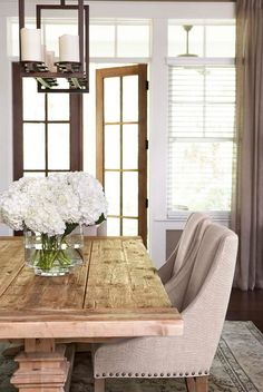 The table and chairs (fabric color: sand) are by Restoration Hardware. The French doors are 8′ tall Mahogany french doors. The rug is a one-of-a- kind antique Persian Tabriz rug. The draperies were custom made from Robert Allen Sheer Linen.