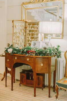 Vintage Dresser , Suitcase & Key Table Plan Wedding Decor - Katy Melling Photography   Vintage wedding at Eshott Hall, Northumberland   Rosa Clara Wedding Dress   Red Flowers