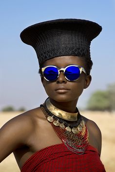DSC_7133; Etnia; South Africa; 2013. A woman with blue sunglasses and black hat…