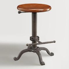 Blending vintage charm and modern functionality, our adjustable stool boasts a wooden seat finished in warm chestnut and an industrial-style metal swivel base for a reclaimed look. It features a swivel mechanism that adjusts its height to bar or counter level.