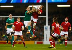Luke Fitzgerald of Ireland challenges Matt Evans of Canada for the high ball during the 2015 Rugby World Cup Pool D match between Ireland and Canada at the Millennium Stadium on September 19, 2015 in Cardiff, United Kingdom. (Photo by Laurence Griffiths/Getty Images)