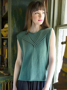Admit by Norah Gaughan -- Eyelets beautifully frame the neckline of this sleeveless top.