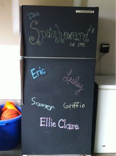 Painted the old refrigerator in our garage with chalkboard paint.