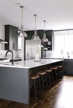 Modern Kitchen Interior black, white, grey, wood kitchen with oversized kitchen island // anne sage - Get sustainable kitchen design ideas from Cambria quartz countertops, which are manufactured in the USA at a plant that recycles of its water! Grey Kitchen Designs, Interior Design Kitchen, City Kitchen Design, Interior Ideas, White Kitchen Interior, Grey Interior Design, Home Decor Kitchen, New Kitchen, Kitchen Ideas