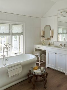 The master bathroom's exposed ceiling and lack of symmetry made it a challenging space to design. A pure all-white color scheme—check out the Thassos marble walls and Bianco Dolomiti counters—keeps everything cohesive. The beautiful cast-iron bathtub, not too deep, is ideal for the children | archdigest.com