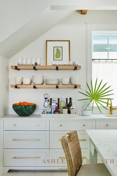 ASHLEY GILBREATH INTERIOR DESIGN: Open shelving in this Rosemary Beach carriage house kitchen keeps the space light and airy. Beach House Kitchens, Home Kitchens, Coastal Kitchens, Ashley Gilbreath, Small Dining, Dining Area, Rosemary Beach, Beautiful Beach Houses, Maine House