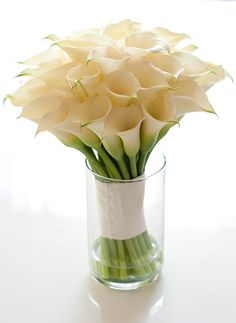 Calla Lillies make a beautiful bouquet no matter what your wedding theme and can also be used as a table centerpiece.