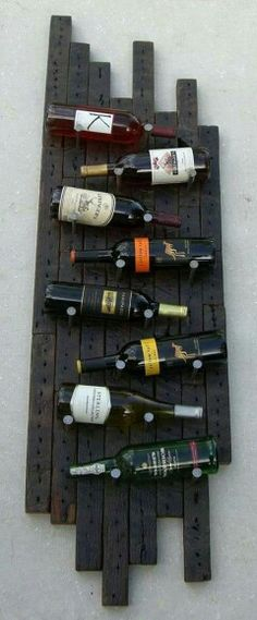 Reclaimed wood wine rack rustic wine rack to going to get my fella to make one for our home! > Like the layout if the bottles but maybe on a slab of live edge wood? Pallet Projects, Home Projects, Rustic Wine Racks, Wood Anniversary Gift, Wedding Anniversary, Do It Yourself Furniture, Pallet Shelves, Wine Storage, How To Distress Wood