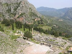 Ruins of the theatre and of the temple of Apollo at Delphi. The pan-Hellenic sanctuary of Delphi, where the oracle of Apollo spoke, was the site of the omphalos, the 'navel of the world'. Blending harmoniously with the superb landscape and charged with sacred meaning, Delphi in the 6th century B.C. was indeed the religious centre and symbol of unity of the ancient Greek world.