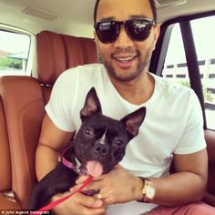 'Newest family member!' John Legend posed with he and Chrissy Teigen's new furry friend, a rescued three-legged French Bulldog named Penny http://dailym.ai/1oD7Jkc