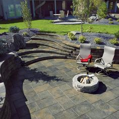 Stone Oasis Circle Firepit surrounded by Dynasty Slate Slabs.