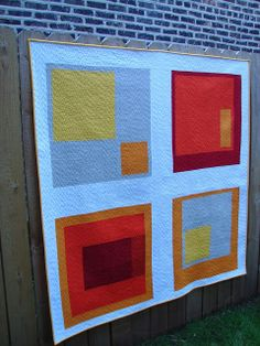 Modern four-block quilt. I LOVE THIS!!!!