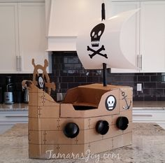 Boys Kids Costume, DIY Cardboard Pirate Ship ⋆ Tamara's Joy - - This DIY Cardboard Pirate Ship is an easy build that will make your children smile. I made this DIY Cardboard Pirate Ship in one afternoon using a box and a. Diy Pirate Costume For Kids, Homemade Pirate Costumes, Pirate Kids, Pirate Halloween Costumes, Diy Costumes, Halloween Stuff, Halloween Makeup, Costume Ideas, Cardboard Costume
