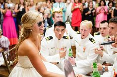 ABSOLUTELY IN LOVE with this Top Gun homage. Navy pilot husband, beautiful bride, good-looking groomsman. Swooooon