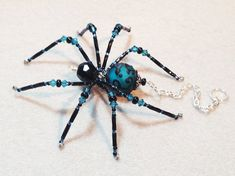 Olivia  black and teal glass beaded spider goth sun by llanywynns, $18.00