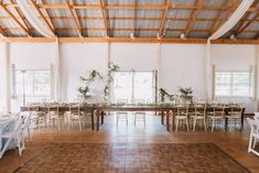 Head table for entire bridal party, gold chairs, barn reception, wood table, dark wood gold chairs, greenery, wedding inspiration