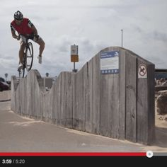 Martyn Ashton does some crazy tricks on a road bike