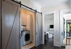 White Laundry Room Cabinets With Gray Countertop - Design photos, ideas and inspiration. Amazing gallery of interior design and decorating ideas of White Laundry Room Cabinets With Gray Countertop in laundry/mudrooms by elite interior designers. Hidden Laundry Rooms, Door Design, House, Basement Laundry Room, Home, Laundry Doors, Interior Sliding Barn Doors, Room Remodeling, Laundry Room Doors