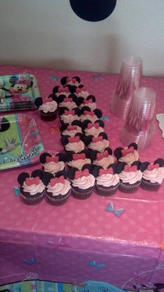 Minnie mouse cupcakes. I made these for my granddaughters birthday! Chocolate cupcakes, black fondant for the ears, Cut into circles, Pink fondant for the bow. Pink Pearl Nonpareils placed in the light pink frosting. Everyone loved them!