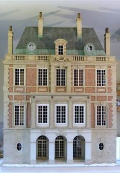 Outstanding Dollhouse, four floors, great detail and design.  Rick Maccione-Dollhouse Builder www.dollhousemansions.com