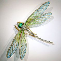 Stunning Art Nouveau dragonfly pin (attributed to Eugene Feuillatre) mounted en tremblant, its wings plique-a-jour enamel and edged in rose-cut diamonds. Its head with green enamel eyes and a diamond. From Fred Leighton. Late 19th/early 20th C. - $37,500
