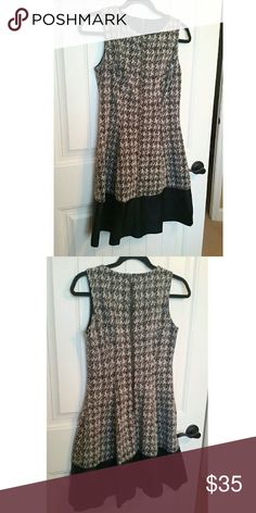 NWOT Houndstooth Ralph Lauren Dress This dress is brand new from Ralph Lauren. The tags are cut out but I'm guessing that it is a size 2 or small. The bottom black section is faux leather. Lauren Ralph Lauren Dresses Mini