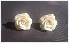 Lovely stud earrings with hand sculpted clay roses. Earrings are made with hypoallergenic studs.  Size: 15 mm.  Handmade by me with care, love &