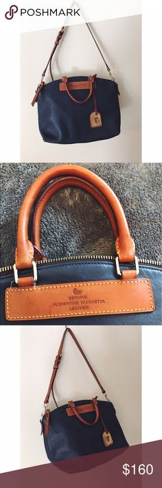 Dooney & Bourke Leather Satchel This navy blue satchel has hardly been used and is in near-perfect condition! Genuine florentine vacchetta leather! Dooney & Bourke Bags Satchels