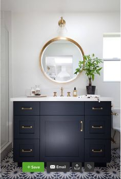 http://www.houzz.com/projects/1164039/paradise-cove-guest-house-malibu-ca Vanity paint: custom (similar: Black Blue, Farrow & Ball); mirror: Made Goods; lighting: Schoolhouse Electric & Supply Co.; hardware: Liz's Antique Hardware; floor tile: Eastern Promise in Tangier Pallazzo, 6¾ by 6¾ inches, Martin Lawrence Bullard for Ann Sacks