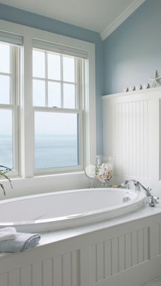 White tub with a view of the ocean