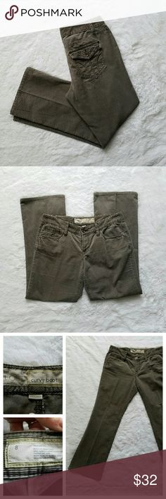 """{LOFT} Gray Corduroy Bootcut Pants Really cozy, extremely cute bootcut cords from Ann Taylor Loft. """"Curvy Boot"""" style, with flare at the bottom. A darker gunmetal gray; very well maintained. EUC.  Button flap back pockets. 8.5"""" rise. 30"""" long inseam. 16"""" waist across, laying flat.   I also offer a 20% bundle discount. Cheers! LOFT Pants Boot Cut & Flare"""