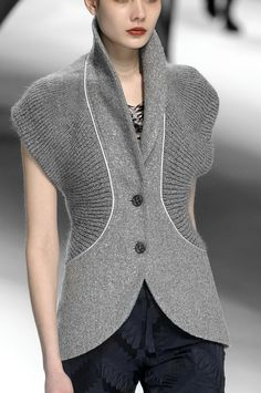 Beautiful style that combines knitting and fabric. Issey Miyake F/W '10 - knit ribs with woven fabric.