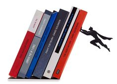 Floating Bookshelves Held Up By a Magnetic Superhero