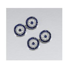 PAIR OF SAPPHIRE AND DIAMOND CUFFLINKS. Each annular link centring on a circular-cut sapphire within a diamond set surround further bordered by French-cut sapphire