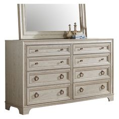 A smooth surface and washed wood finish give this dresser the presence of an heirloom. From the Orlando collection, it's detailed with eight drawers; tw...
