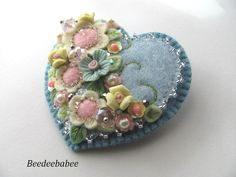 4/28/15  Hi! This heart pin is done in very pretty shades of blue, pink and yellow. Flower beads, faceted glass beads, and a hint of a silvery