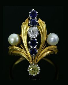 Art Nouveau Yellow Sapphire Ring.   Natural pearl, Old European cut diamond, sapphire, yellow sapphire, 18K. France 1890-1900.