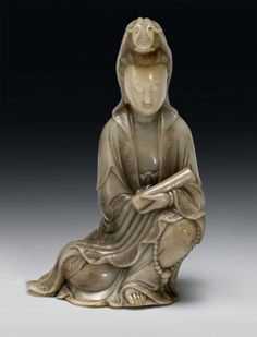 A SOAPSTONE FIGURE OF GUANYIN QING DYNASTY, 18TH/19TH CENTURY
