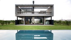 Glass walls enclose the courtyard of this concrete house in Argentina, designed by architects María Belén García Bottazzini and Ekaterina Künzel. Concrete Houses, Concrete Floors, Amazing Architecture, Contemporary Architecture, Internal Courtyard, Concrete Structure, Building Companies, Radiant Heat, Dark Interiors