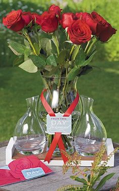 Very neat alternative to the unity candle - You have a flower for the bride and groom, and then each member of the bridal party. They carry the roses down the aisle then add them to the vase. During the ceremony, the bride and groom add their own to the large center vase as well.