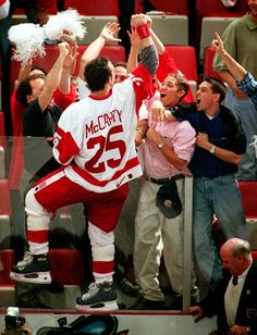 Darren McCarty climbed the glass to share a celebratory moment with Wings fans after their 1997 Cup win.