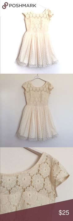 """Cream lace tulle polkadot fit and flare dress 1 Cream lace tulle polkadot fit and flare dress, excellent condition. Tulle lined skirt with lace upper and peekaboo top. Sweetheart neckline, cap sleeves and zip back. Pit to pit 16"""", waist 13"""", length 33"""". Poly blend. Urban Outfitters Dresses"""