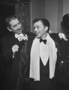 Thomas C Clark takes Sinatra's coat.
