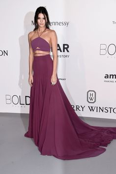 Jenner is the belle of the ball in this deep purple Calvin Klein halter gown.   - MarieClaire.com