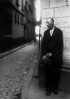 Unemployed Man, 1928. Anticipating Germany's economic decline, Sander poignantly ended his book Face of the Time with a picture of an unemployed man loitering on a street corner. With shaved head and torn clothing, he has lost all attributes of honor and social respectability. [Getty Museum note]